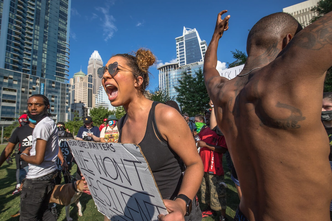 In this May file photo, demonstrators marched in Charlotte after George Floyd's death in Minneapolis. (Photo by Grant Baldwin for Cardinal & PIne)