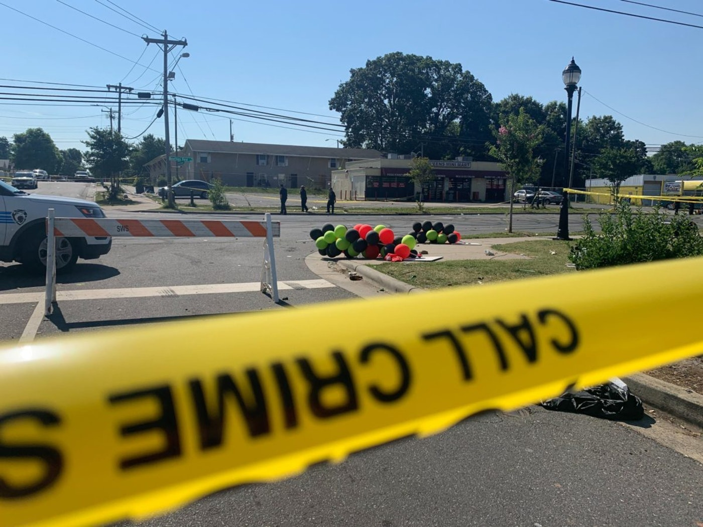 Police tape is seen near the scene of a shooting early Monday, June 22, 2020 in Charlotte, North Carolina, that resulted in four deaths and several more people injuries. (AP Photo/Sarah Blake Morgan)