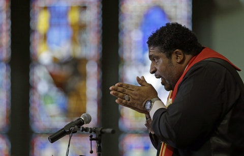 In this Wednesday, June 24, 2015 photo, Rev. William Barber speaks at Pullen Memorial Baptist Church in Raleigh, N.C. in this 2015 file photo. (AP Photo/Gerry Broome)
