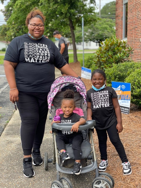 Brittney Pickett organized a Black Lives Matter protest in the small, rural Eastern North Carolina town of Beulaville. Here she is pictured with her daughters Ta'Keira, 6, and Bri'Elle, 1. Image via Pickett.