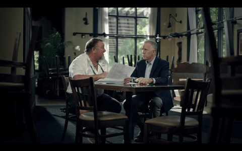 Sen. Thom Tillis continues to run an ad featuring a restaurant owner accused of racial bias. (Image via screenshot)
