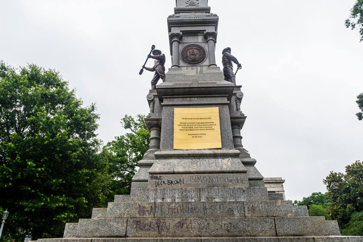 A plaque in honor of George Floyd was added to the Confederate monument on the Capitol grounds during a protest. (Image via Shutterstock)