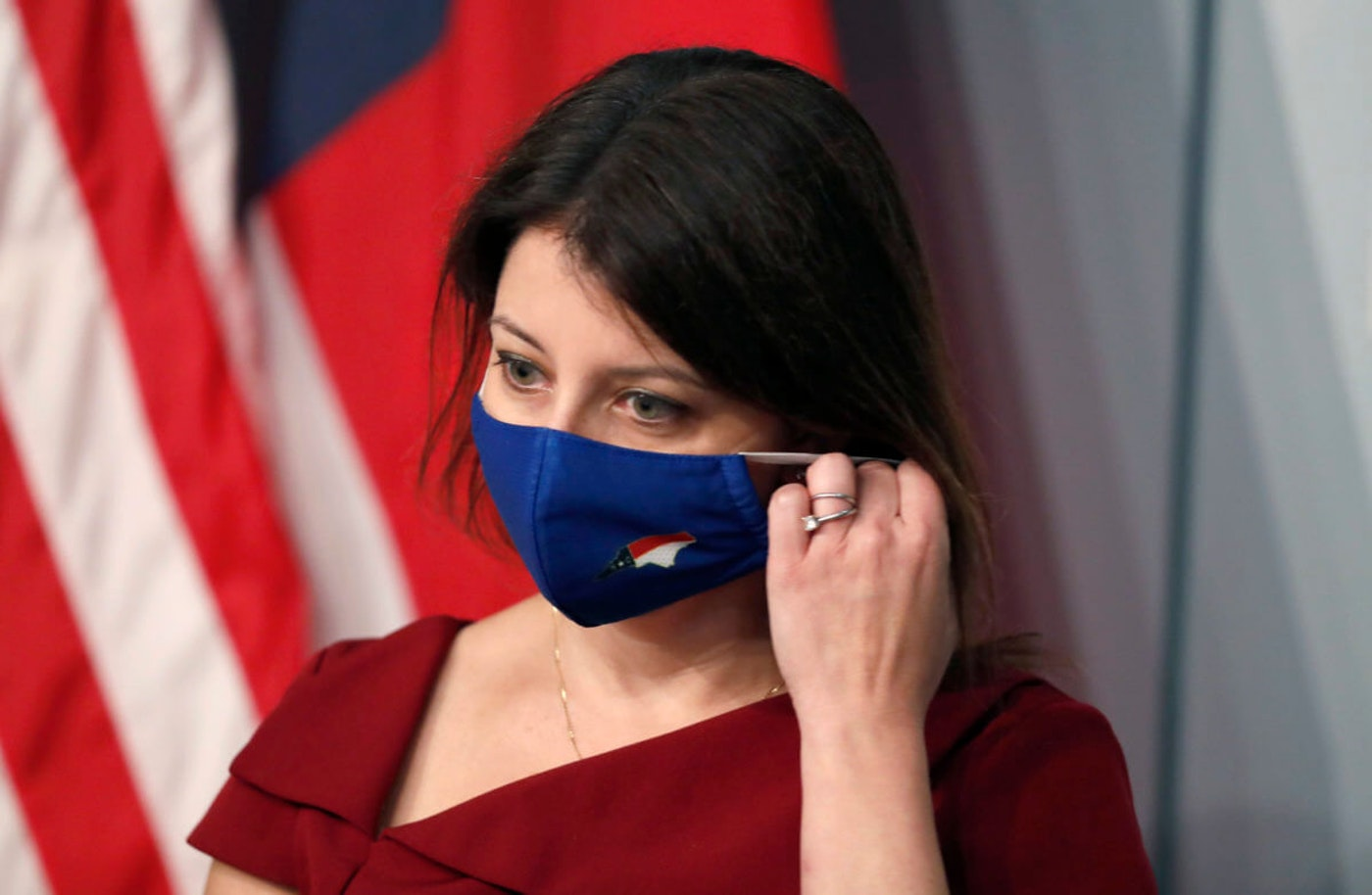 NC DHHS Secretary Mandy Cohen dons a mask this month during a coronavirus media briefing. (Image via NC DPS)