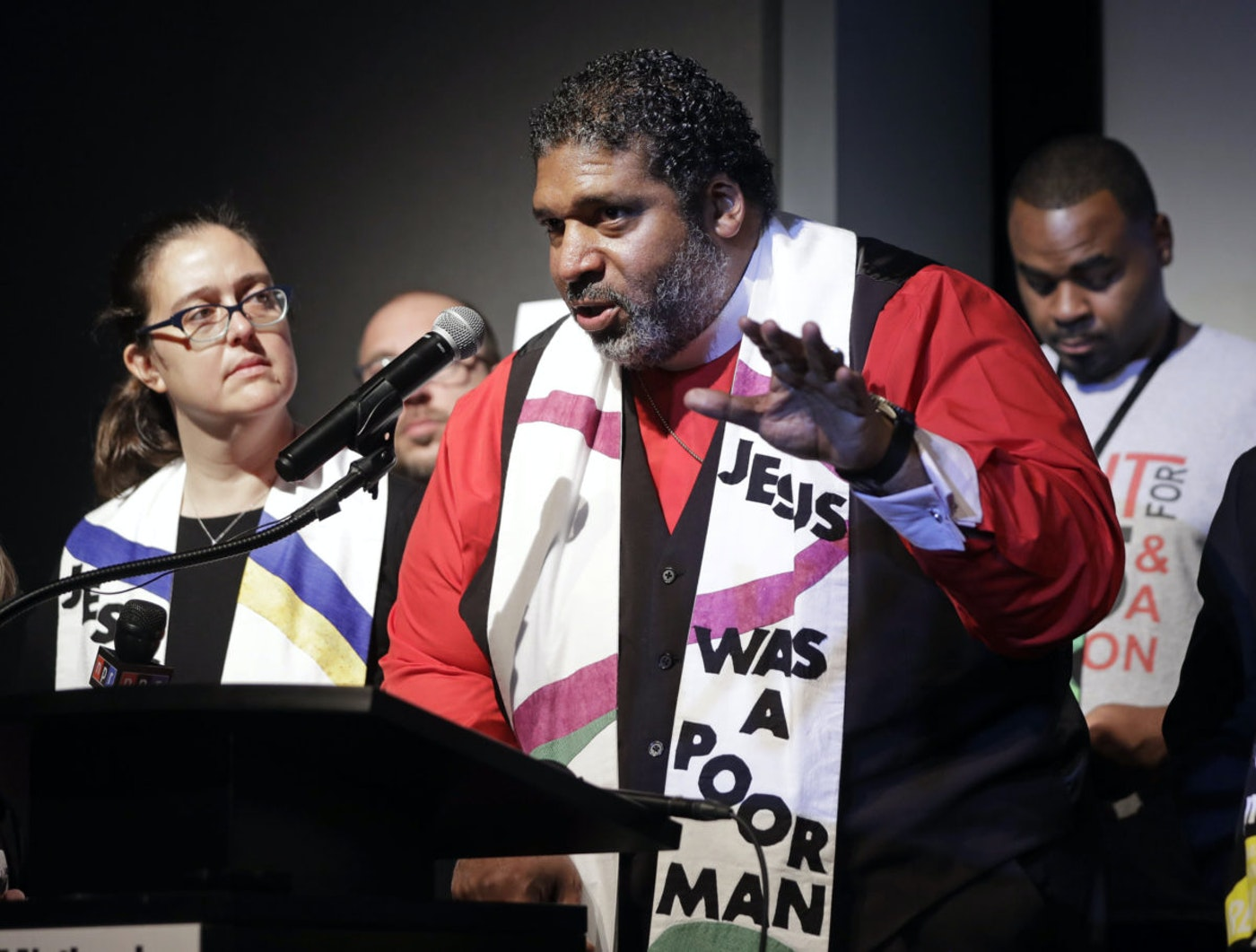 In this April 2, 2018 file photo,  Rev. Dr. William J. Barber II, center, and Rev. Dr. Liz Theoharis, left, co-chairs of the Poor People's Campaign, speak at the National Civil Rights Museum in Memphis, Tenn. Barber led a town hall on the US Senate race Tuesday. (AP Photo/Mark Humphrey)