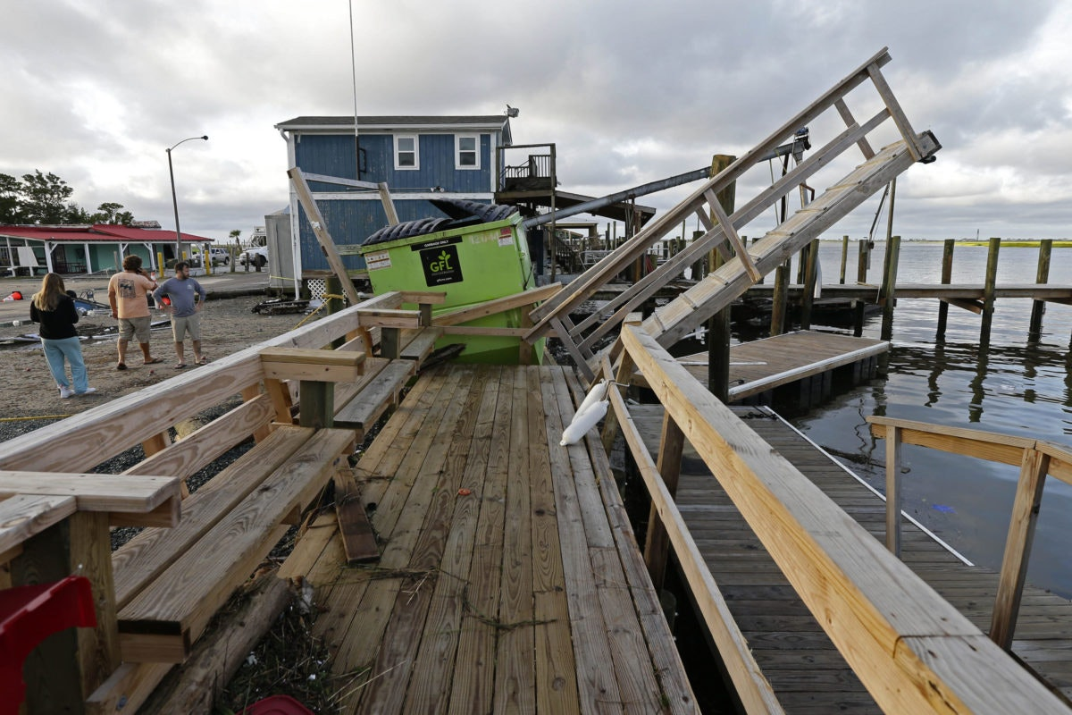 A waterfront dock shows damage following the effects of Hurricane Isaias in Southport, N.C., Tuesday, Aug. 4, 2020. A nearby nuclear plant reportedly lost power early Tuesday, spurring safety fears at the facility. (AP Photo/Gerry Broome)