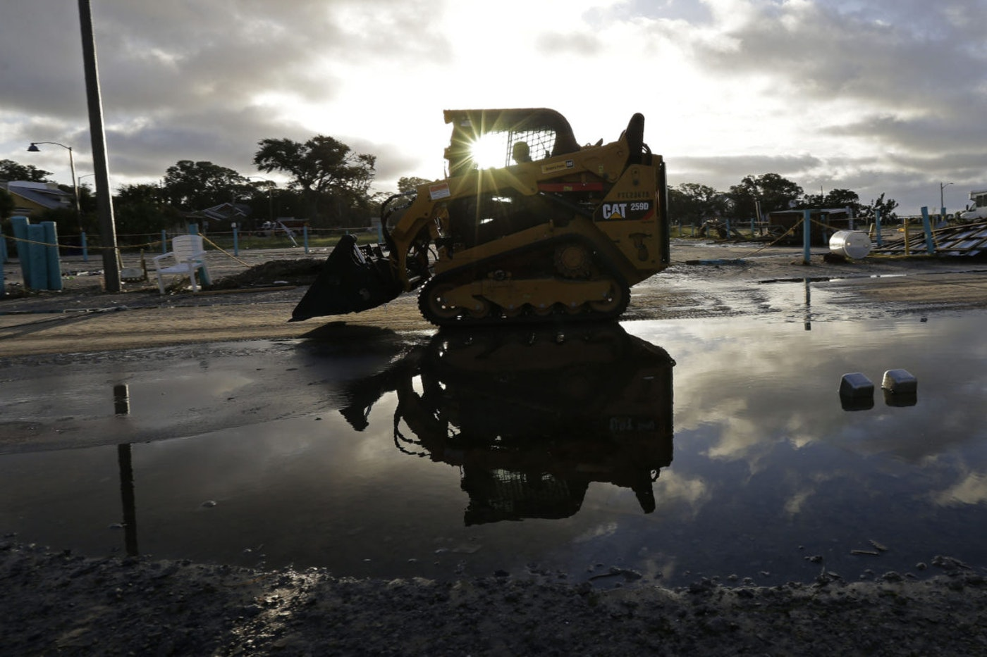 Cleanup begins following the effects of Hurricane Isaias in Southport, N.C., Tuesday, Aug. 4, 2020. The storm is past but researchers are expecting an extremely active hurricane season. (AP Photo/Gerry Broome)