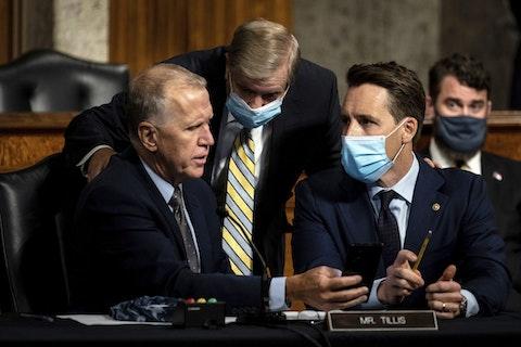 Sen. Thom Tillis, R-N.C., talks with Senate Judiciary Committee chairman Sen. Lindsey Graham, R-S.C., and Sen. Joshua Hawley, R-Mo., during a Senate Judiciary Committee oversight hearing on Capitol Hill in Washington, Wednesday, Aug. 5, 2020 (Erin Schaff/The New York Times via AP)
