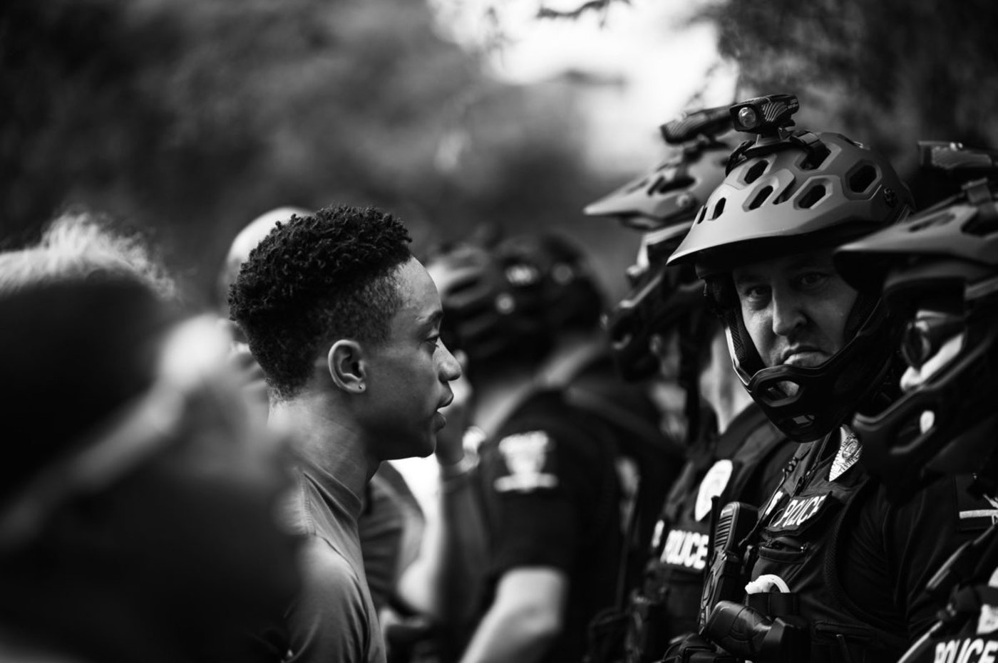 Anti-Trump protesters clashed with counterprotesters and police outside of the Republican National Convention Monday in Charlotte. Our reporter witnessed police using their bikes as weapons against demonstrators and pepper spraying one young man. (Image for Cardinal & Pine by Alvin Jacobs Jr.)