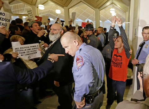 In this 2016 file photo, a protestor, right, is handcuffed and removed from the House gallery as demonstrators interrupted a special session of the NC General Assembly. (AP Photo/Gerry Broome)