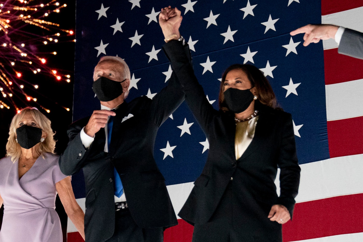 Democratic presidential candidate former Vice President Joe Biden and his running mate Sen. Kamala Harris, D-Calif., watch fireworks during the fourth day of the Democratic National Convention, Thursday, Aug. 20, 2020, at the Chase Center in Wilmington, Del. (AP Photo/Andrew Harnik)