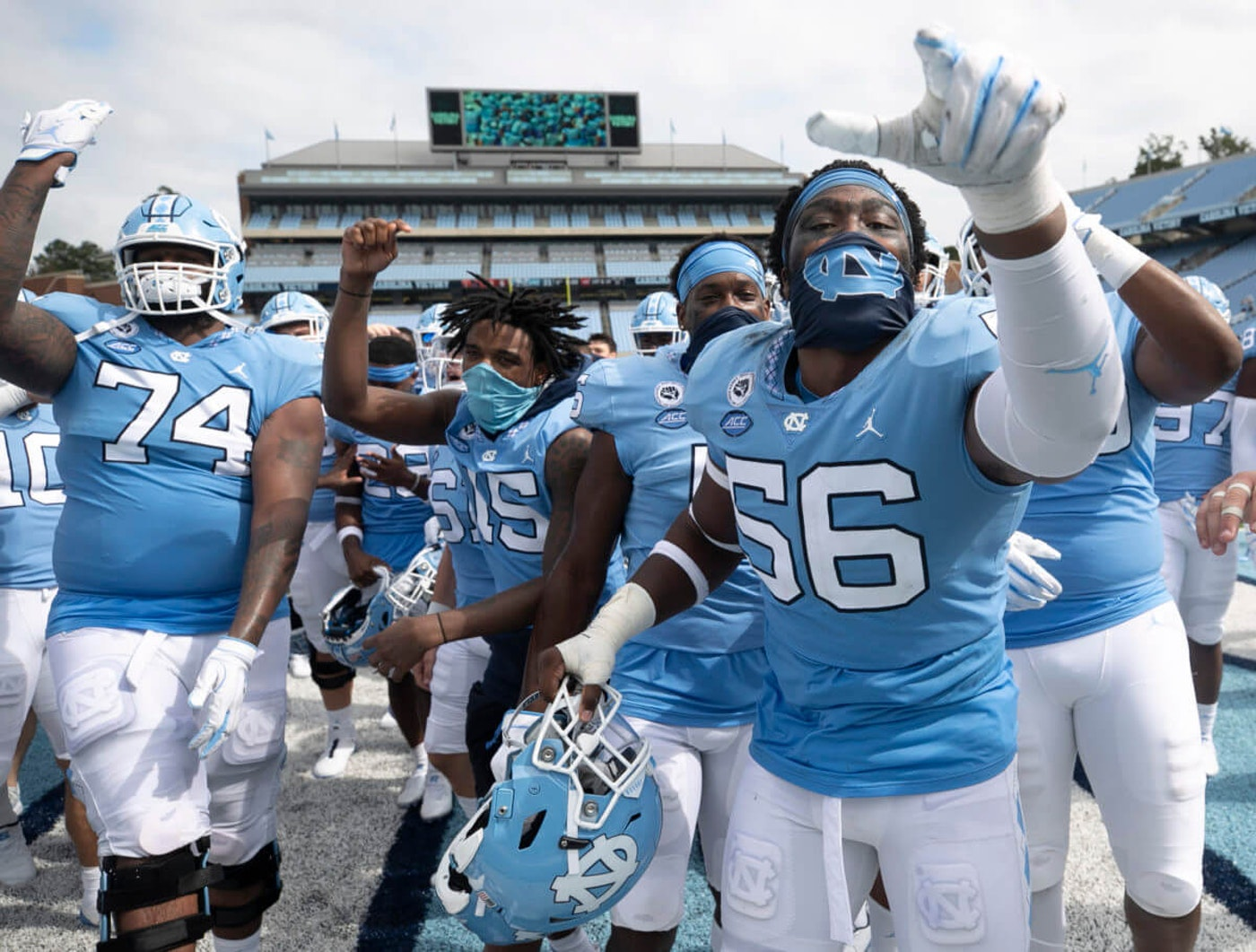 UNC-Chapel Hill football player Tomari Fox (56) and his teammates celebrate their victory over Syracuse on Saturday, Sept. 12, 2020, in Chapel Hill, N.C.(Robert Willett/The News & Observer via AP, Pool)