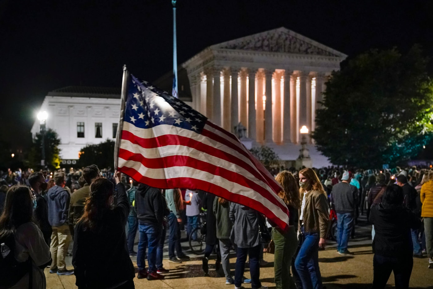 People gather at the Supreme Court in Washington, Saturday night, Sept. 19, 2020, to honor the late Justice Ruth Bader Ginsburg, one of the high court's liberal justices, and a champion of gender equality. Her death leaves a vacancy that could be filled with a more conservative justice by President Donald Trump. (AP Photo/J. Scott Applewhite)