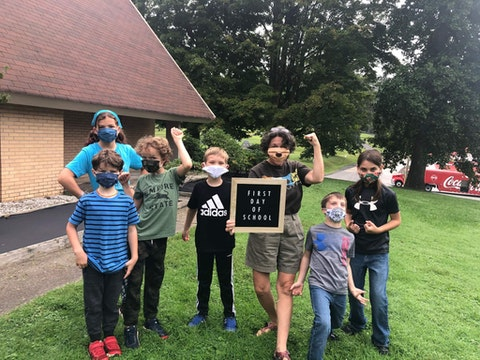 The author, Sue Wasserman, holding the sign, with 'The Pod Squad,' her attempt to launch a small learning pod in western NC. (Image submitted by Sue Wasserman)