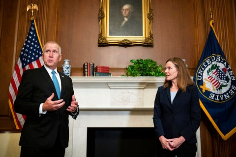Sen. Thom Tillis, R-N.C., meets with Judge Amy Coney Barrett, President Donald Trump's nominee to the Supreme Court at the U.S. Capitol Wednesday, Sept. 30, 2020, in Washington. (Bill Clark/Pool via AP)
