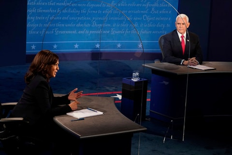 Vice President Mike Pence looks at Democratic vice presidential candidate Sen. Kamala Harris, D-Calif., as she answers a question during the vice presidential debate Wednesday, Oct. 7, 2020, at Kingsbury Hall on the campus of the University of Utah in Salt Lake City. (AP Photo/Morry Gash, Pool)
