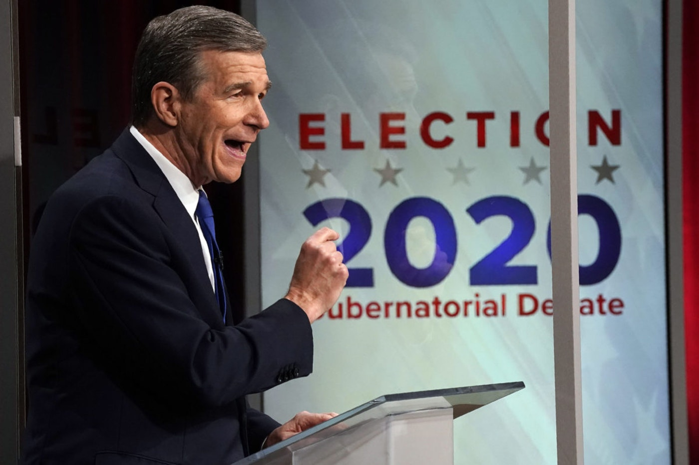 North Carolina Gov. Roy Cooper makes a comment during a live televised debate with and Lt. Gov. Dan Forest at UNC-TV studios in Research Triangle Park, N.C., Wednesday, Oct. 14, 2020. (AP Photo/Gerry Broome)