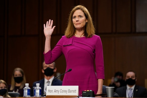 Supreme Court nominee Amy Coney Barrett is sworn in during a confirmation hearing before the Senate Judiciary Committee, Monday, Oct. 12, 2020, on Capitol Hill in Washington. State officials in NC say North Carolinians have much at stake if the US Supreme Court with Barrett overturns the Affordable Care Act. (AP Photo/Patrick Semansky, Pool)