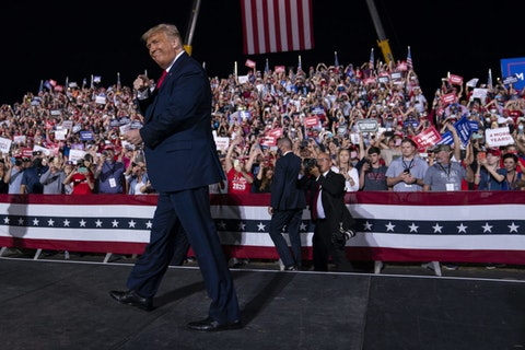 President Donald Trump arrives for a campaign rally at Gastonia Municipal Airport, Wednesday, Oct. 21, 2020, in Gastonia, N.C. The president might be drawing crowds, many of them without masks, to NC, but a veteran state pollster is predicting wins for Joe Biden and other Democrats. (AP Photo/Evan Vucci)
