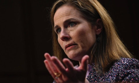US Supreme Court Justice Amy Coney Barrett testifies before the Senate Judiciary Committee in October. Some worry that the Trump-stocked Supreme Court with Barrett on board is a threat to same-sex marriage rights. (Photo by Andrew Caballero-Reynolds-Pool/Getty Images)