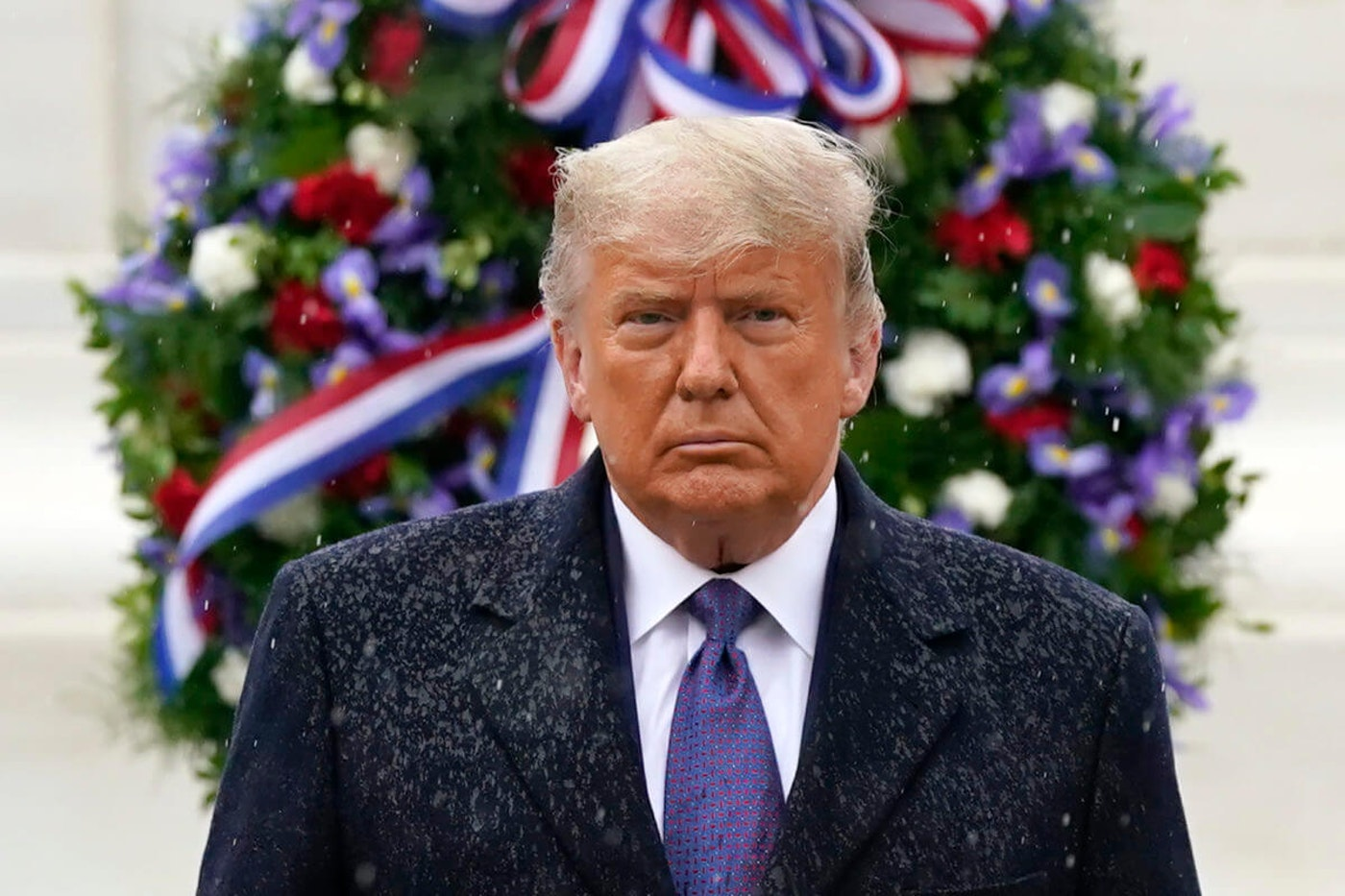 President Donald Trump participates in a Veterans Day wreath laying ceremony at the Tomb of the Unknown Soldier at Arlington National Cemetery in Arlington, Va., Wednesday, Nov. 11, 2020. Most credible news outlets have called the election for Democrat Joe Biden, but Trump has refused to concede. (AP Photo/Patrick Semansky)