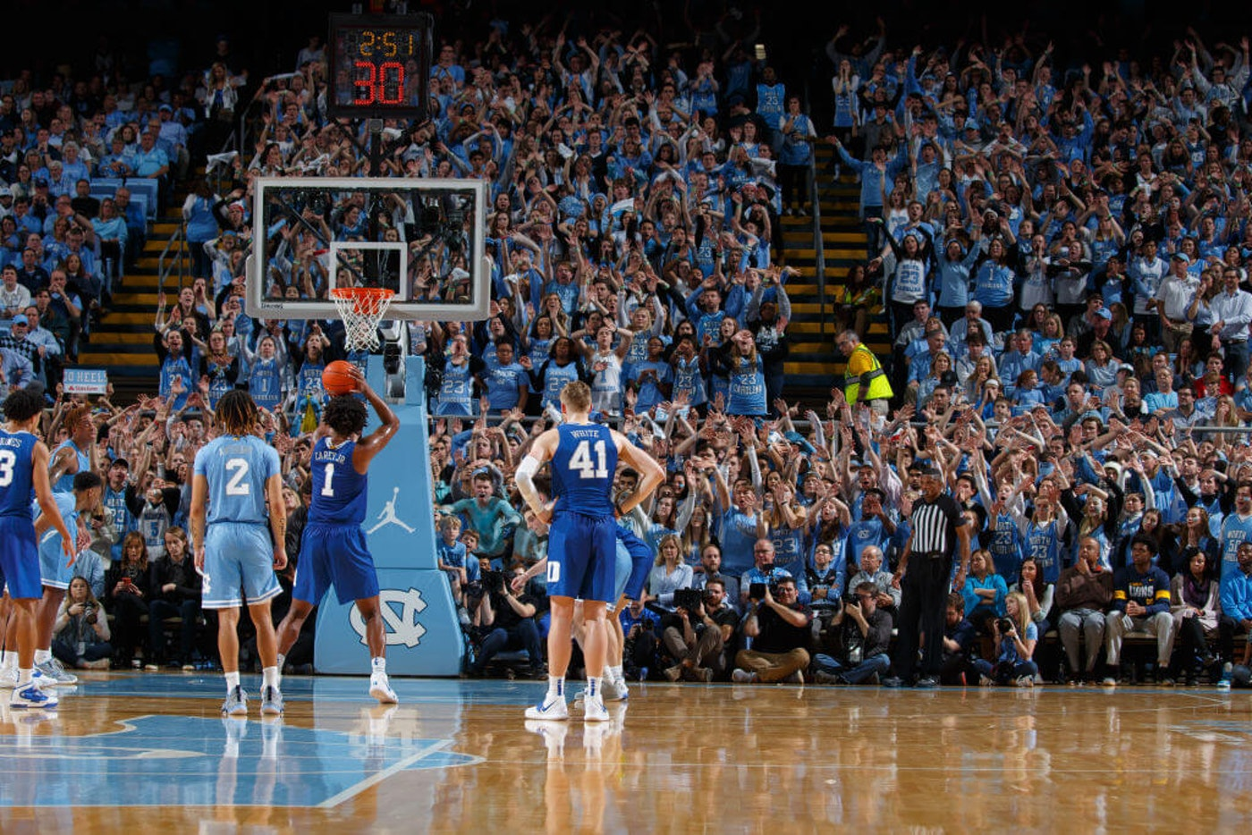 Duke and UNC-Chapel Hill square off in February in Chapel Hill. College basketball is expected to return in the coming days, although the pandemic will blunt the economic impact. (Photo by Peyton Williams/UNC/Getty Images)