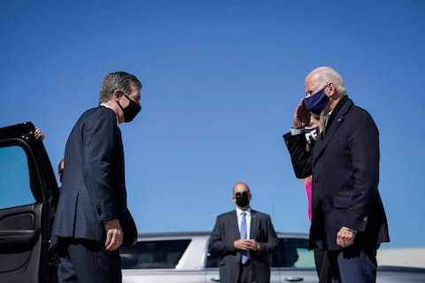"Gov. Roy Cooper (L) greets then-Democratic presidential nominee Joe Biden in Raleigh in October 2020. Cooper says it is ""critical"" for North Carolina that Congress passes Biden's American Jobs Plan. (Photo by Drew Angerer/Getty Images)"