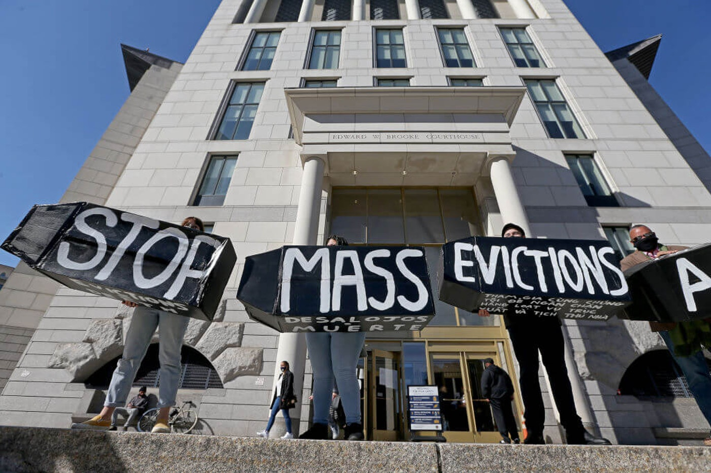 Protesters hold signs during a rally to prevent Massachusetts evictions in October. Experts say inconsistent enforcement of a federal eviction ban has troubled renters in states such as North Carolina. (Matt Stone/ MediaNews Group/Boston Herald)