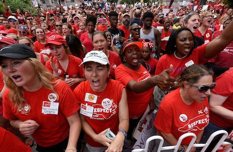 NC educators protest near the General Assembly building in Raleigh in 2018. Education funding was a major point of conflict in the state in the last decade, particularly longstanding funding inequities between urban and rural counties. (Photo by Sara D. Davis/Getty Images)