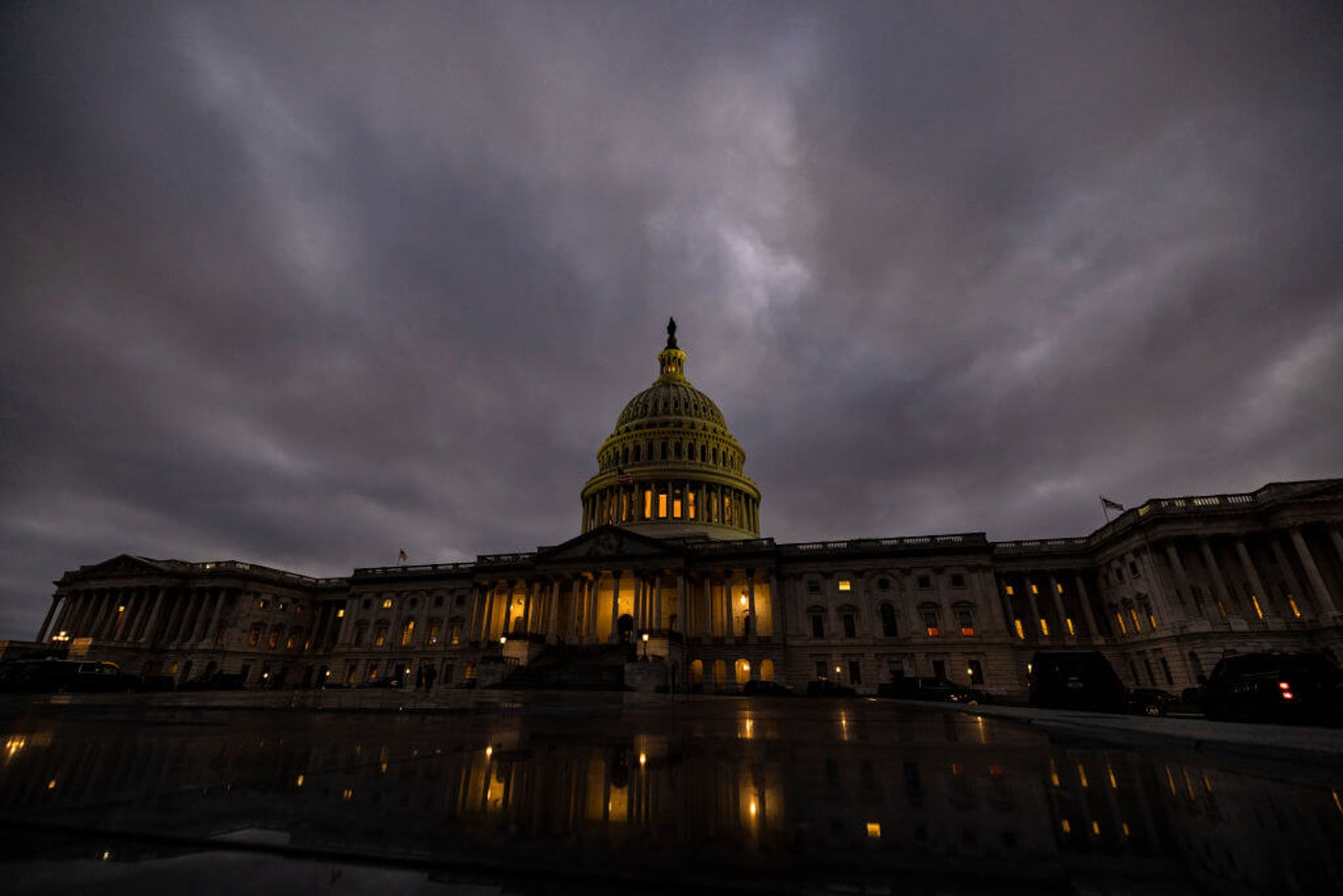 WASHINGTON, DC - DECEMBER 20: Dusk falls over the US Capitol building on December 20, 2020 in Washington, DC. Republicans and Democrats in the Senate finally came to an agreement on the coronavirus relief bill and a vote is expected later today or tomorrow. (Photo by Samuel Corum/Getty Images)
