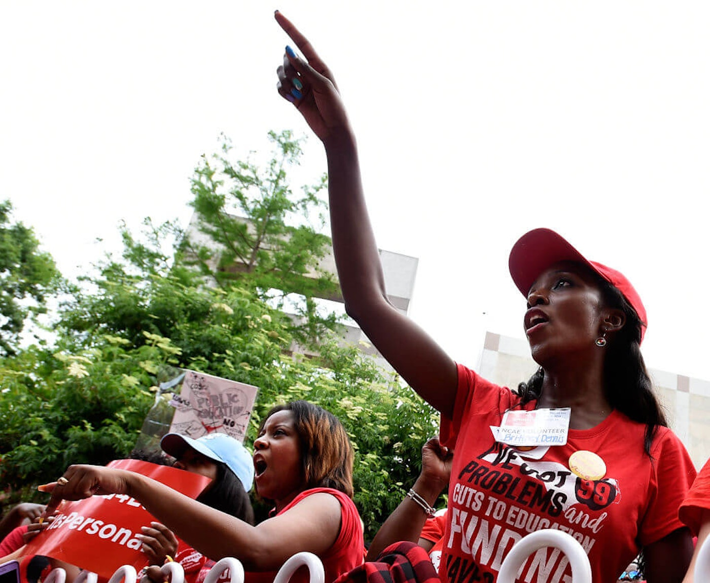 Crowds cheer during the Rally for Respect outside the North Carolina Legislative Building on May 16, 2018 in Raleigh, North Carolina. Several North Carolina counties closed schools to allow teachers to march on the opening day of the General Assembly.  (Photo by Sara D. Davis/Getty Images)