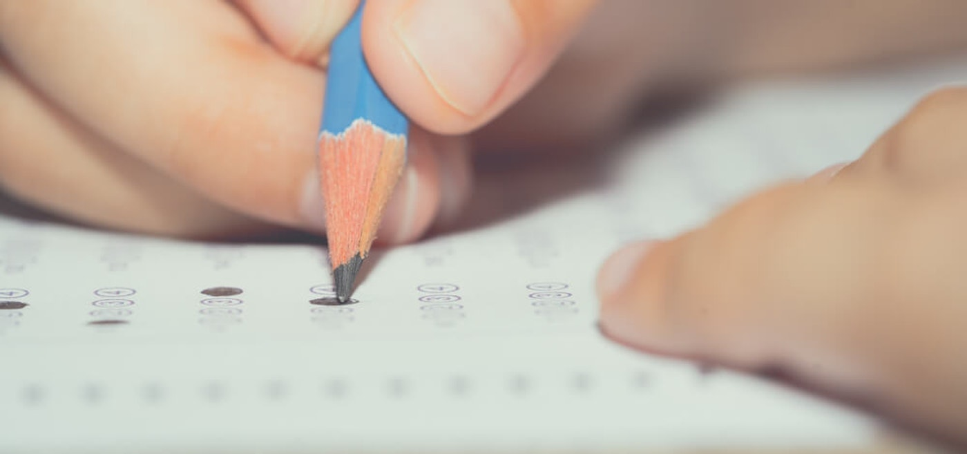 Some parents and educators are fired up over a plan to return NC students to schools for in-person testing this month. (Image via Shutterstock)
