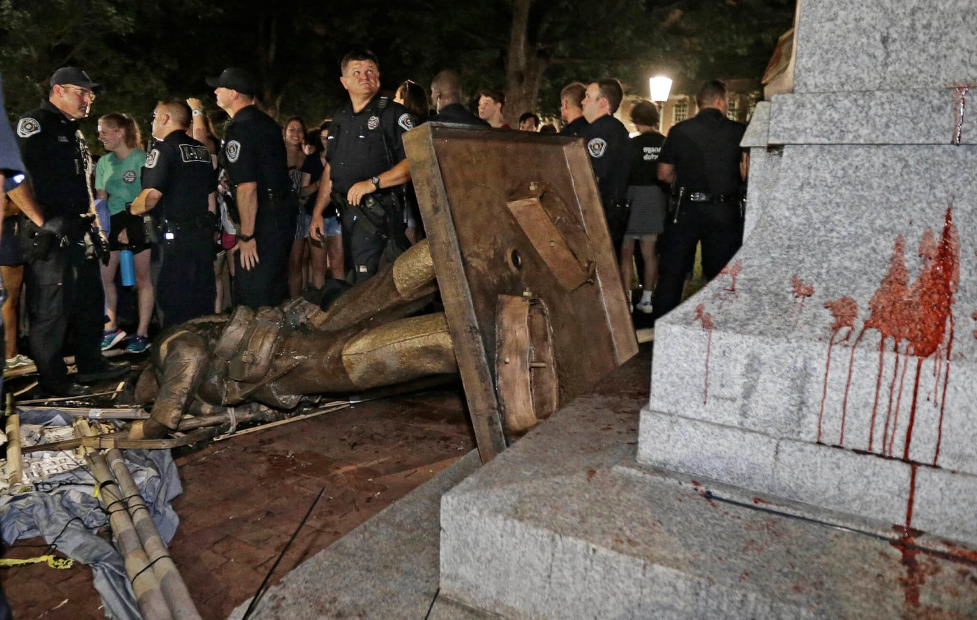 Police stand guard after the confederate statue known as Silent Sam was toppled in Aug. 2018 by protesters on campus at the University of North Carolina in Chapel Hill, N.C.  (File photo by AP Photo/Gerry Broome, File)