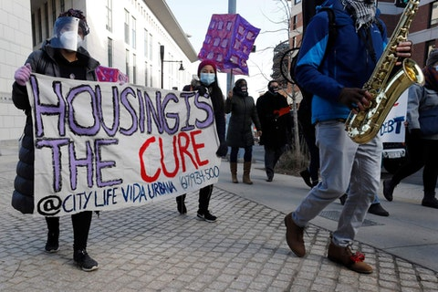 Tenants' rights advocates march in Boston on Jan. 13. The protest was part of a national day of action calling on the incoming Biden administration to extend the eviction moratorium initiated in response to the COVID-19 pandemic. (Phota via AP Photo/Michael Dwyer)