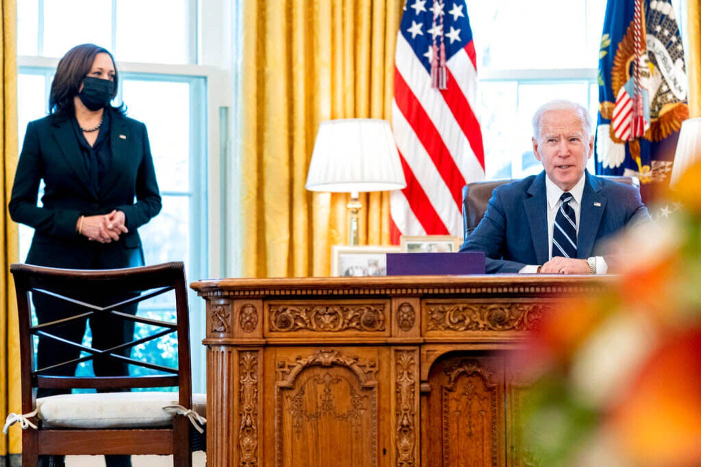 President Joe Biden, accompanied by Vice President Kamala Harris, speaks before signing the American Rescue Plan, a coronavirus relief package, in the Oval Office of the White House Thursday. Image via AP Photo/Andrew Harnik.