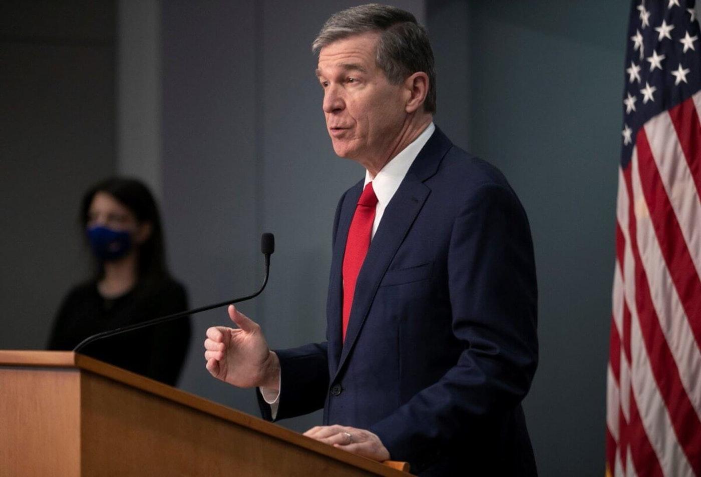 Gov. Roy Cooper speaks in March at a COVID-19 media briefing. (Image via NCDPS)