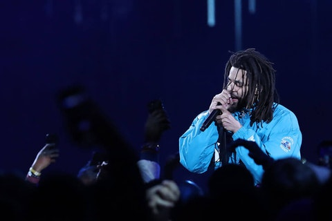 Rapper J. Cole performs during halftime during the NBA All-Star game in 2019 in Charlotte. Coronavirus forced the Fayetteville native to cancel his North Carolina music festival Dreamville in 2020. (Photo by Streeter Lecka/Getty Images)