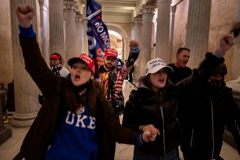Supporters of then President Donald Trump protest inside the US Capitol on January 6, 2021, in Washington, DC. (Photo by Brent Stirton/Getty Images)