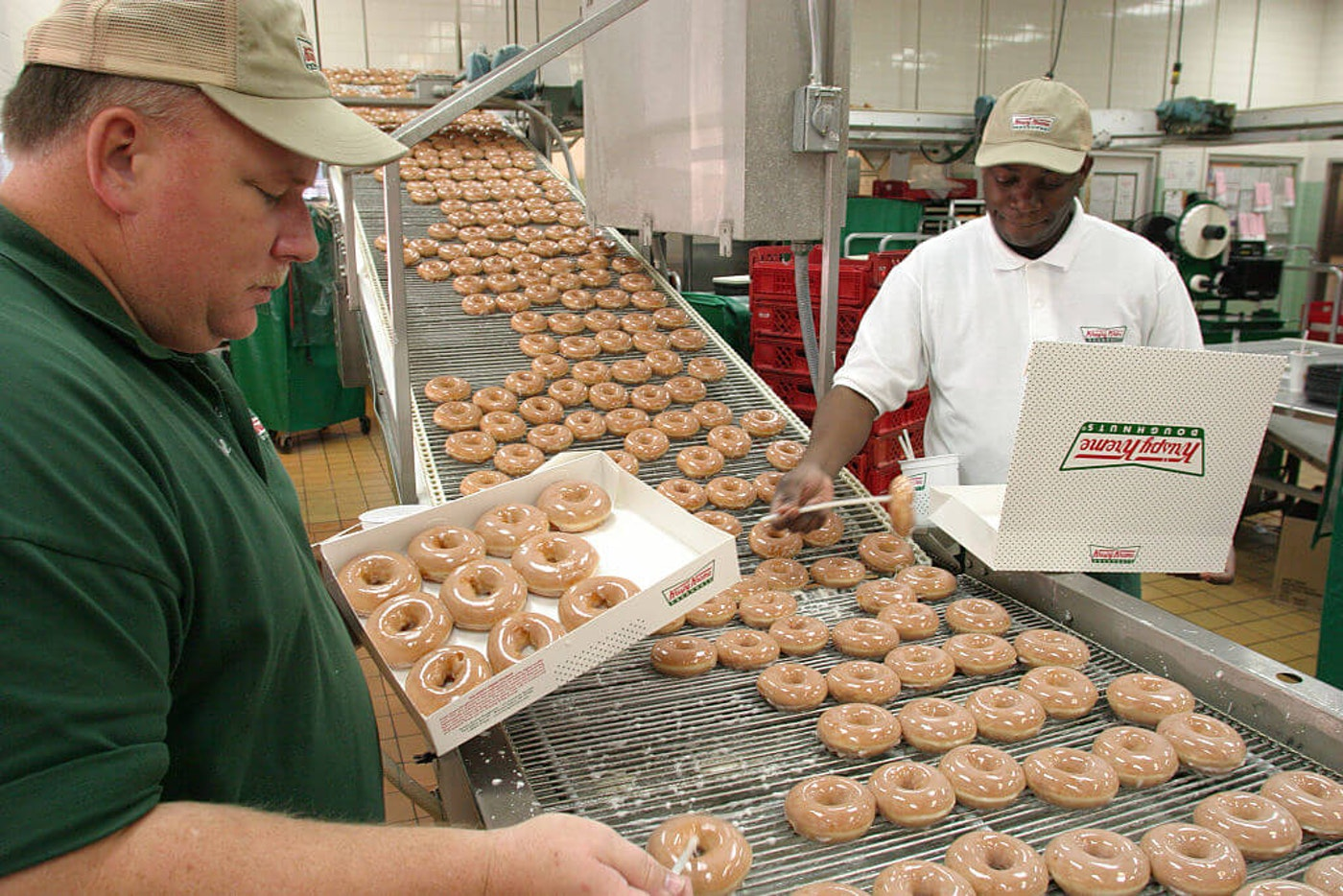 The production line at Krispy Kreme Doughnuts, based out of North Carolina. The famed company is giving away doughnuts to people getting their COVID vaccine. (Photo by: Jeffrey Greenberg/Universal Images Group via Getty Images)