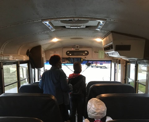 Students unload the bus on the first day of in-classroom learning in Halifax County, North Carolina on March 15, 2021. (Photo by Billy Ball)