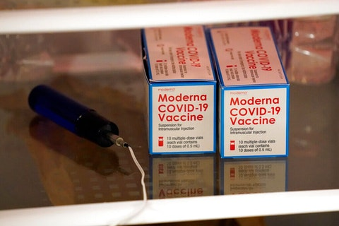 Boxes of the Moderna COVID-19 vaccine are seen Thursday, Jan. 28, 2021 in Pittsboro, N.C. in a refrigerator at Piedmont Health Senior Care, a federally qualified health center. (Image via AP/Gerry Broome)