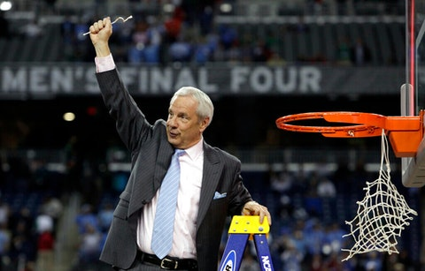 UNC head coach Roy Williams celebrates after his team's 89-72 victory over Michigan State in this file photo from the championship game at the men's NCAA Final Four college basketball tournament in 2009. (Image via AP Photo/Paul Sancya, File)