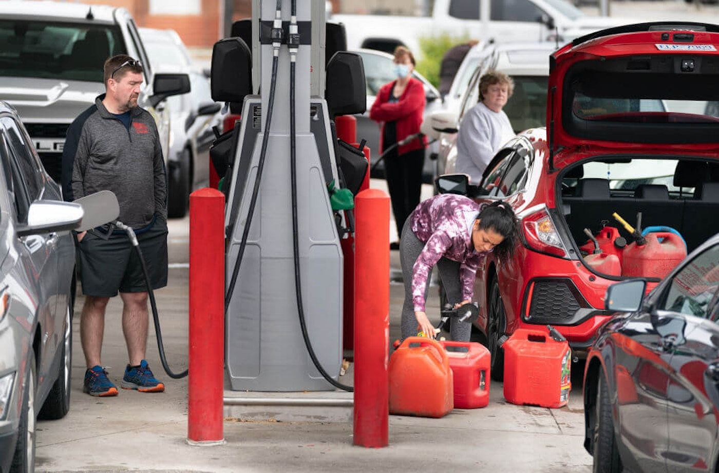 BENSON, NC - MAY 12: Motorists use gas pumps at a refueling station on May 12, 2021 in Benson, North Carolina. Most stations in the area along I-95 are without fuel following the Colonial Pipeline hack. The 5,500 mile long pipeline delivers a large percentage of fuel on the East Coast from Texas up to New York. (Photo by Sean Rayford/Getty Images)
