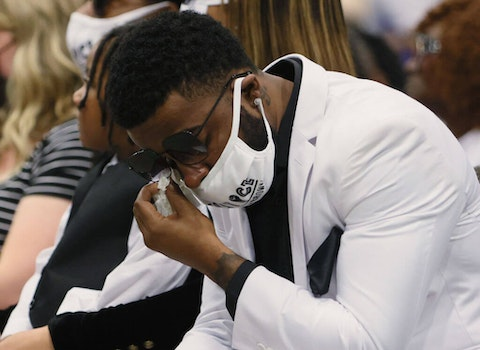 ELIZABETH CITY, NORTH CAROLINA - MAY 03: Jha'rod Ferebee wipes a tear away during the funeral for his father Andrew Brown Jr. at the Fountain of Life church on May 03, 2021 in Elizabeth City, North Carolina. Mr. Brown was shot to death by Pasquotank County Sheriff's deputies on April 21.  (Photo by Joe Raedle/Getty Images)