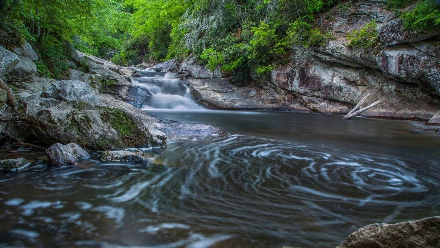 It's summer. Here's Cardinal & Pine's guide to the best swimming holes in North Carolina. (Image via VisitNC)