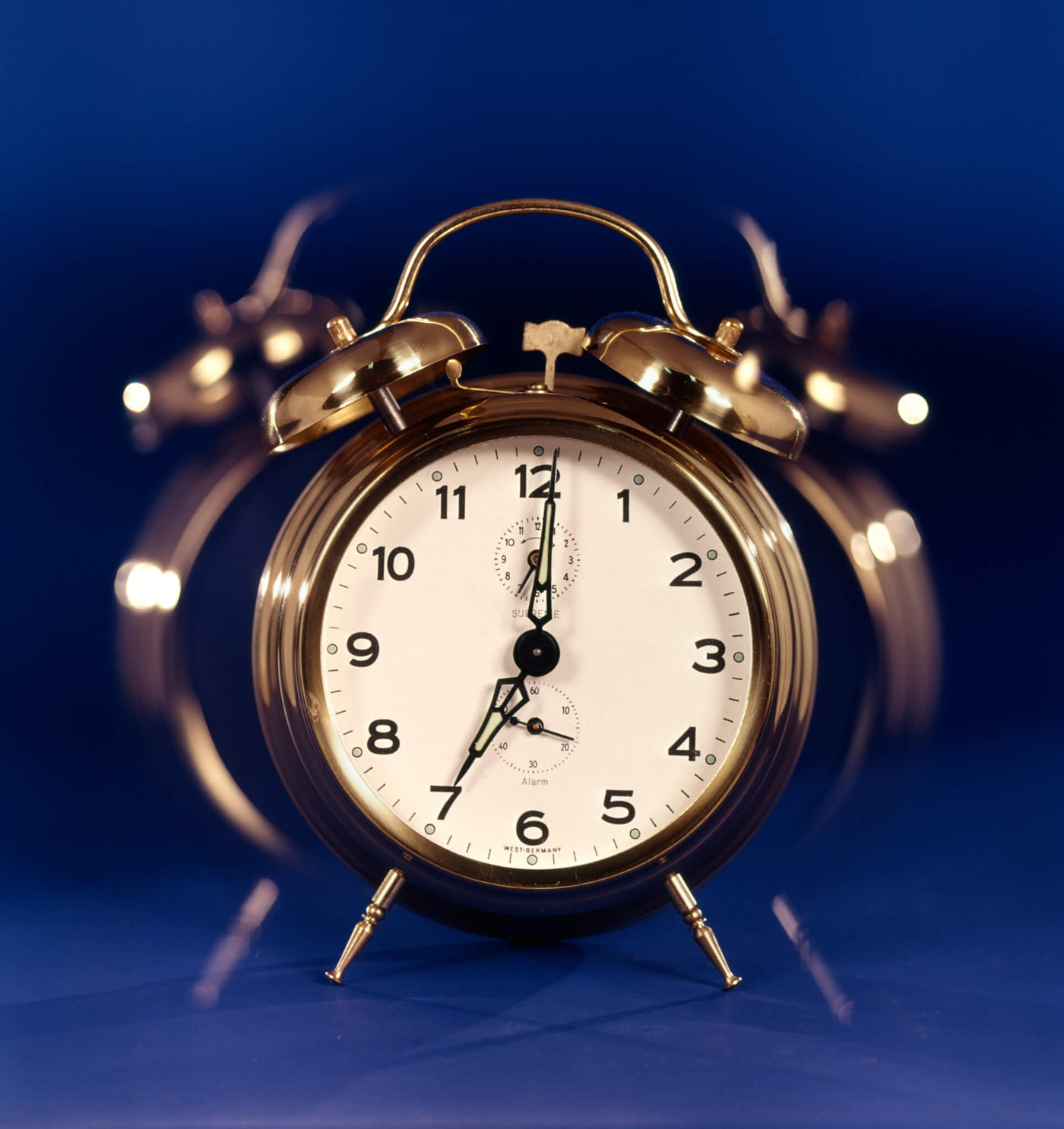 A silver alarm clock illustrates that time is running out for the North Carolina budget to be approved by July 1.