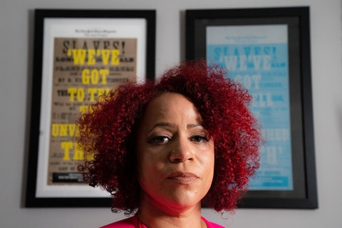 Journalist Nikole Hannah-Jones stands for a portrait at her home in New York, Tuesday, July 6, 2021. A controversy over tenure at UNC-Chapel Hill has supercharged debates in North Carolina about teaching the state's history of racism in K-12 and higher education. (AP Photo/John Minchillo)
