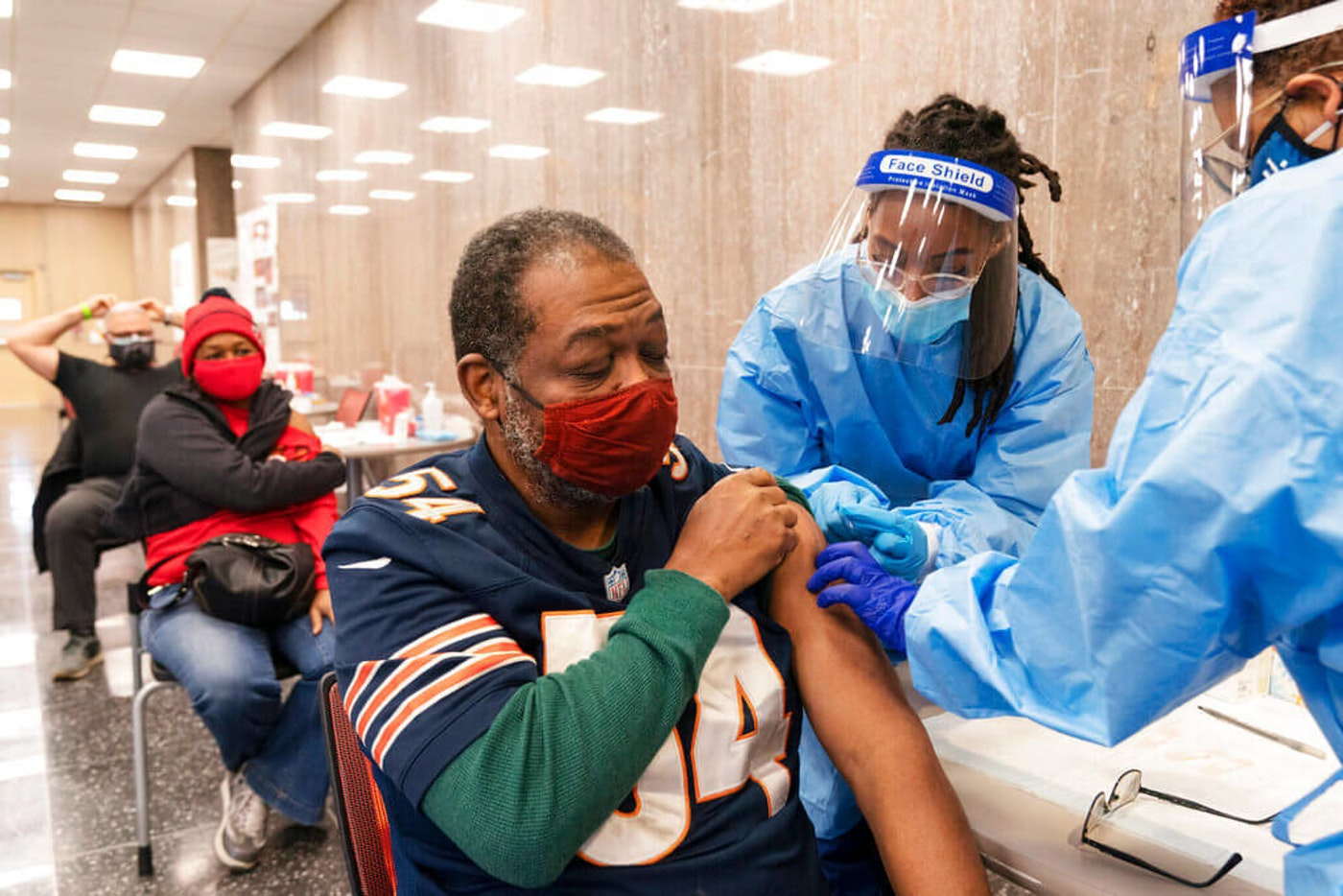 Peter Thomas, 58, of Washington, receives his second dose of the COVID-19 vaccine at a clinic at Howard University in February 2021 (Image via AP Photo/Jacquelyn Martin)