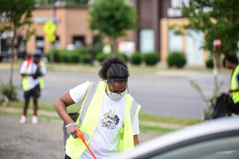 A community clean-up on Beatties Ford Road in Charlotte, NC drew dozens of volunteers June 18, 2021. Residents can more easily request  litter pickup, mowing, and street resurfacing, as well get support for events like this by leaving a message at  www.NCDOT.gov. Pres. Biden's American Jobs Plan would earmark even more taxpayer funds to support improvements in local neighborhoods. (Photo by Alvin C. Jacobs Jr.)