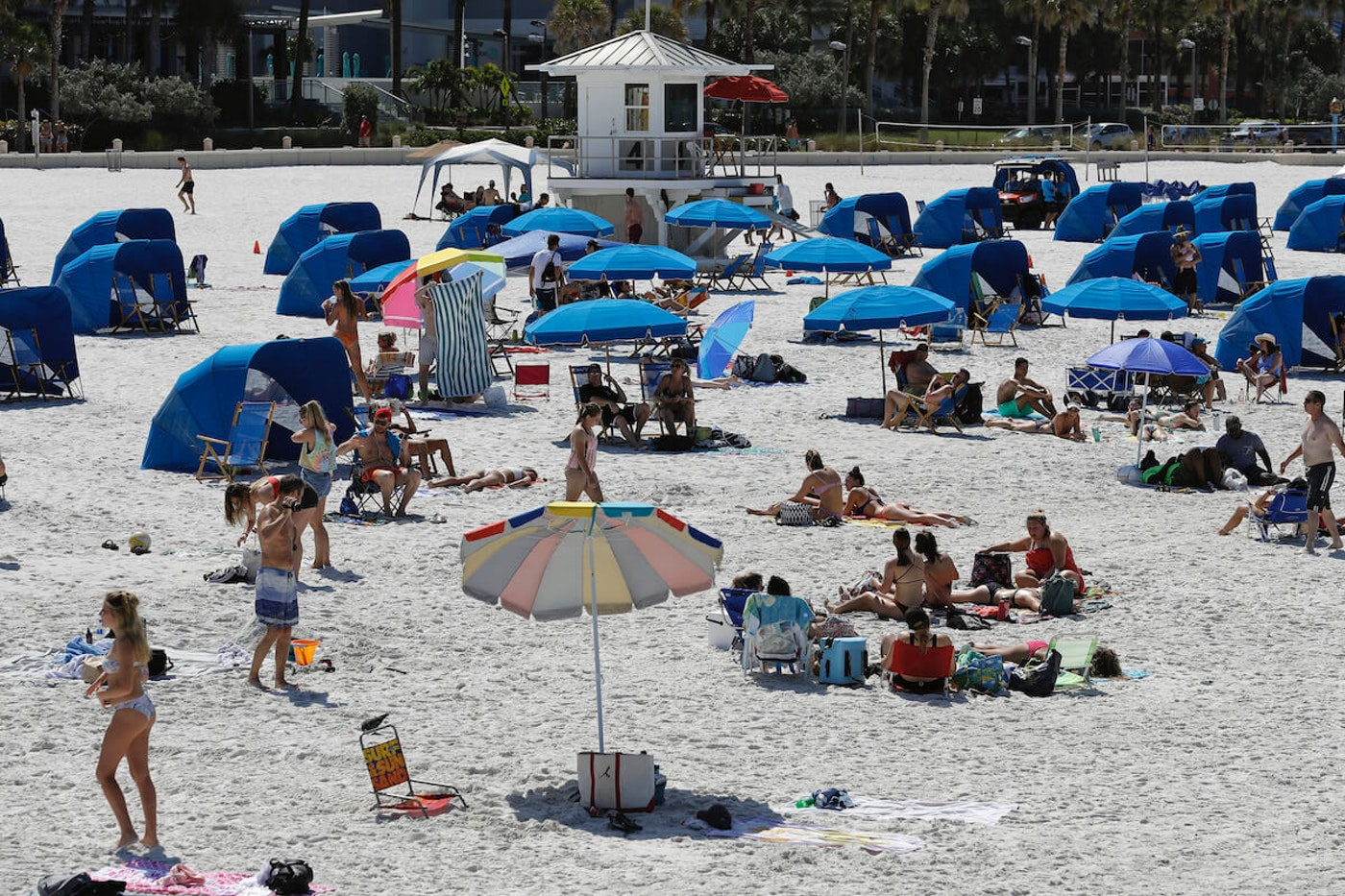 Visitors enjoy Clearwater Beach Wednesday, March 18, 2020, in Clearwater Beach, Fla. Beach goers are keeping a safe distance from each other to help protect from the spread of the coronavirus. (AP Photo/Chris O'Meara)