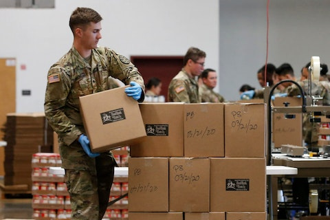 Specialist Colby Chiverton, of the California National Guard stacks boxes of food supplies to be sent out from the Sacramento Food Bank and Family Services in Sacramento, Calif., Saturday, March 21, 2020. AP Photo/Rich Pedroncelli